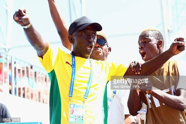 Head coach Ibrahima Ndiaye of Senegal celebrates after the final whistle of the FIFA Beach Soccer World Cup Portugal 2015 Group A match between...