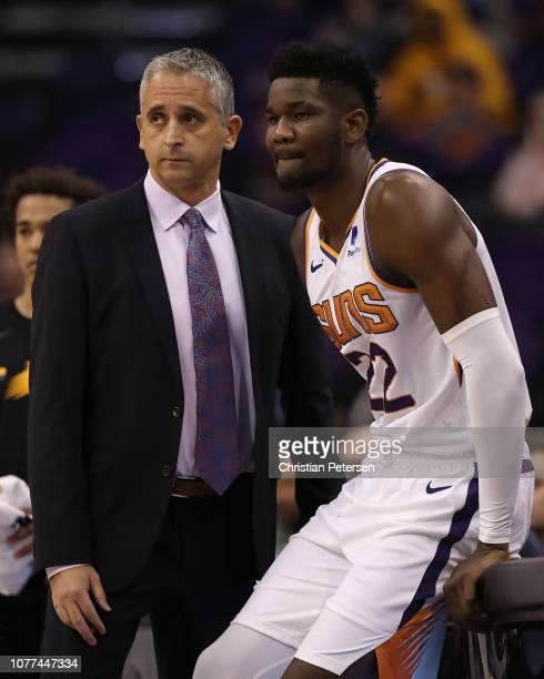 Head coach Igor Kokoskov of Phoenix Suns stands with Deandre Ayton during the first half of the NBA game against the Sacramento Kings at Talking...