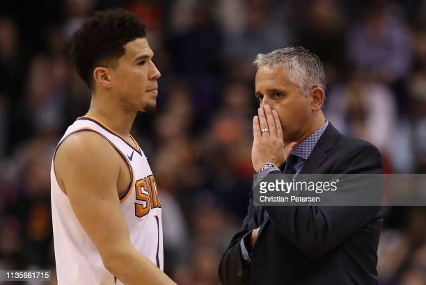 Head coach Igor Kokoskov of the Phoenix Suns talks with Devin Booker during the second half of the NBA game against the Utah Jazz at Talking Stick...