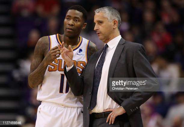 Head coach Igor Kokoskov of the Phoenix Suns talks with Jamal Crawford during the second half of the NBA game against the Houston Rockets at Talking...