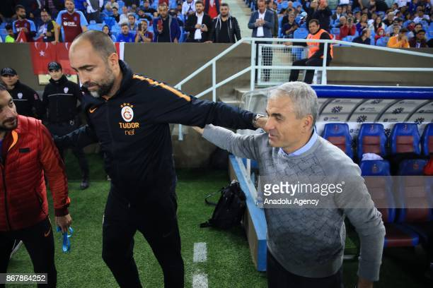 Head coach Igor Tudor of Galatasaray and head coach Riza Calimbay of Trabzonspor wish each other luck ahead of a Turkish Super Lig match between...