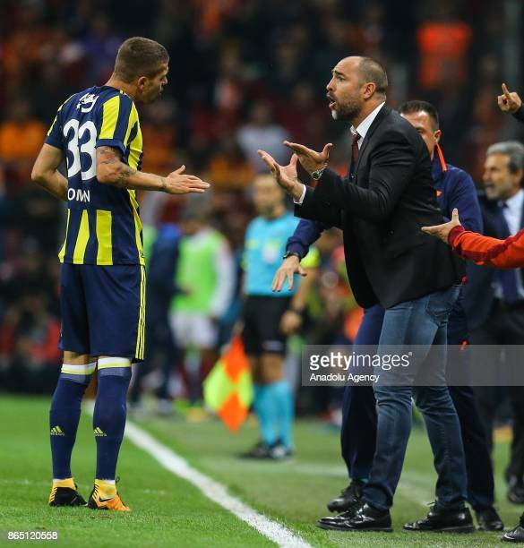 Head coach Igor Tudor of Galatasaray argues with Roman Neustaedher of Fenerbahce during a Turkish Super Lig match between Galatasaray and Fenerbahce...
