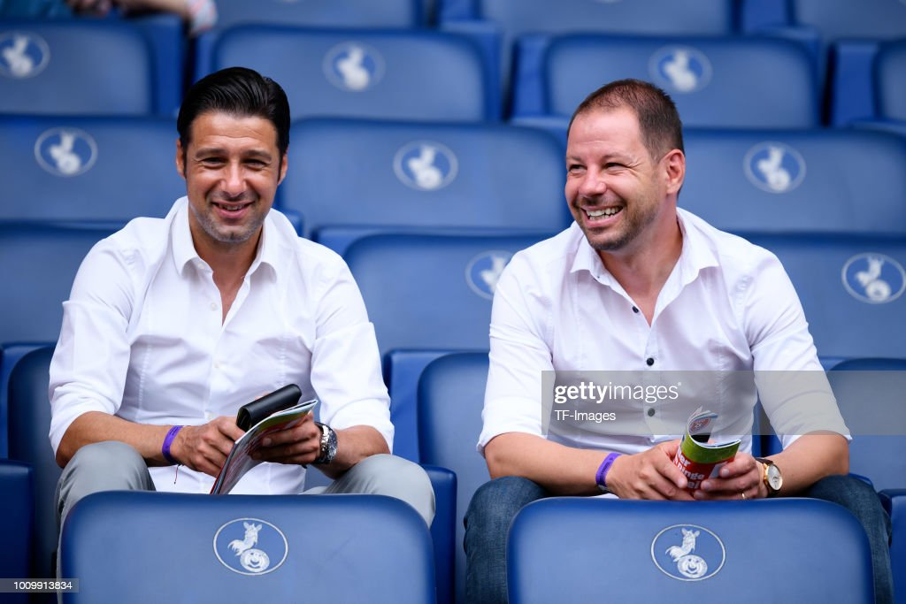 Head coach Ilia Gruev of MSV Duisburg and Assistant coach Yontcho Arsov of MSV Duisburg laugh prior to the 3. Liga match between KFC Uerdingen 05 and SpVgg Unterhaching at Grotenburg-Stadion on July 29, 2018 in Duisburg, Germany.