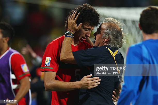 Head coach Ilidio Vale of Portugal hugs Tiago Ferreira after the FIFA U20 World Cup 2011 quarter final match between Portugal and Argentina at...