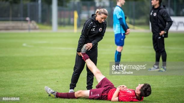 Head Coach Inka Grings helps Can Karaguemrueklue of Koeln during the B Juniors Bundesliga match between Borussia Dortmund and FC Viktoria Koeln on...