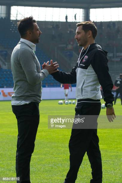 Head coach Ismail Atalan of Bochum shake hands with Head coach Stefan Leitl of Ingolstadt during the Second Bundesliga match between VfL Bochum 1848...