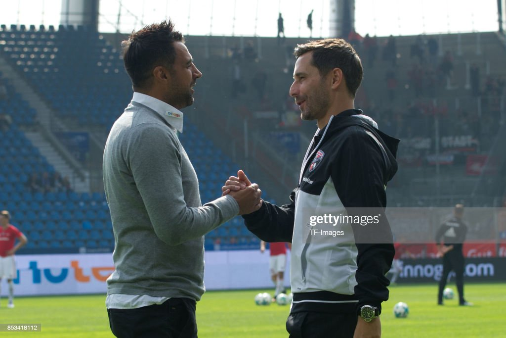 Head coach Ismail Atalan of Bochum shake hands with Head coach Stefan Leitl of Ingolstadt during the Second Bundesliga match between VfL Bochum 1848 and FC Ingolstadt 04 at Vonovia Ruhrstadion on September 24, 2017 in Bochum, Germany.
