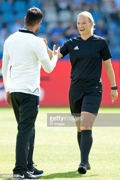 Head coach Ismail Atalan of Bochum shakes hands with Bibiana Steinhaus during the Second Bundesliga match between VfL Bochum 1848 and SG Dynamo...