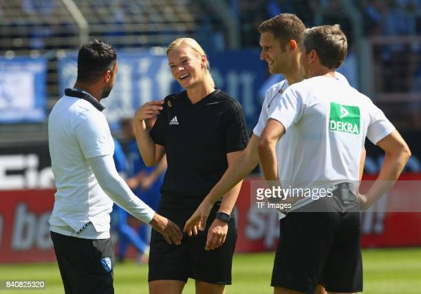 Head coach Ismail Atalan of Bochum speak with Bibiana Steinhaus during the Second Bundesliga match between VfL Bochum 1848 and SG Dynamo Dresden at...
