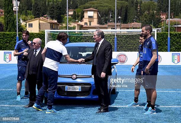 Head Coach Italy Antonio Conte and COO FCA Alfredo Altavilla attend Unveil New Panda Azzurri Car at Coverciano on May 26 2016 in Florence Italy