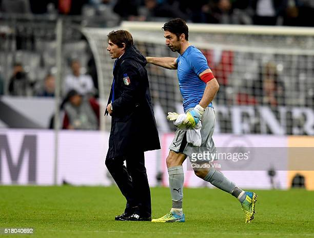 Head coach Italy Antonio Conte and Gianluigi Buffon dejected at the end of the international friendly match between Germany and Italy at Allianz...