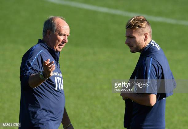 Head coach Italy Gian Piero Ventura and Ciro Immobile of Italy chat prior to the Italy training session at Sisport Mirafiori on October 8 2017 in...