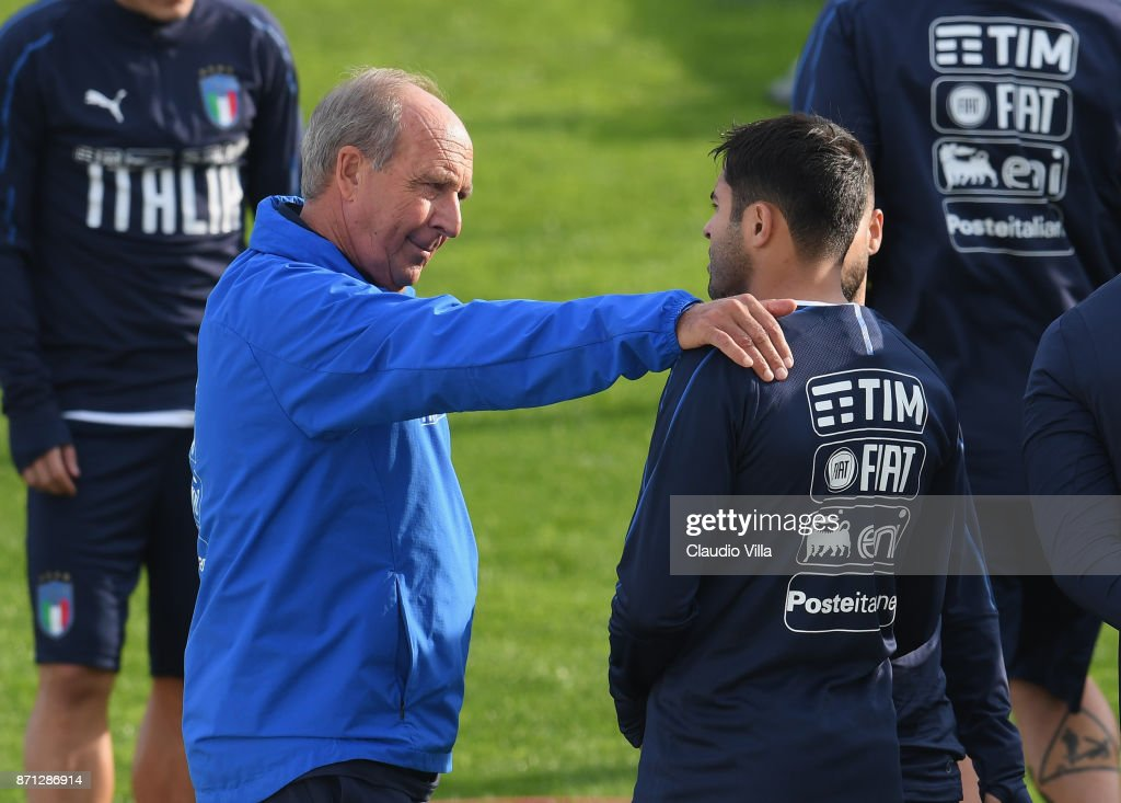 Head coach Italy Gian Piero Ventura (L) and Citadin Martins Eder of Italy chat during a training session at Italy club's training ground at Coverciano on November 7, 2017 in Florence, Italy.