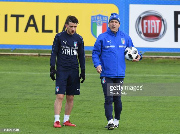 Head coach Italy Luigi Di Biagio and Alessandro Florenzi chat during a training session at Centro Tecnico Federale di Coverciano on March 19 2018 in...