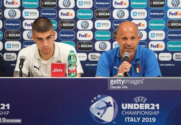 Head coach Italy Luigi Di Biagio and Gianluca Mancini of Italy speak with the media during a press conference at Stadio Renato Dall'Ara on June 18,...