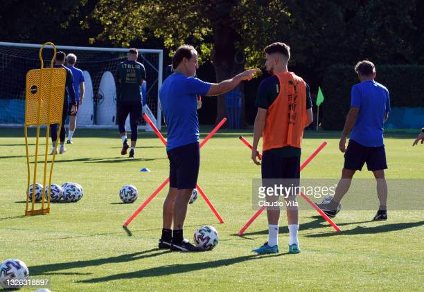 Head coach Italy Roberto Mancini and Jorginho of Italy chat during an Italy training session at Centro Tecnico Federale di Coverciano on June 30,...