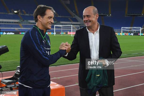 Head coach Italy Roberto Mancini and Nicola Zingaretti chat during the training session at Stadio Olimpico on October 11 2019 in Rome Italy