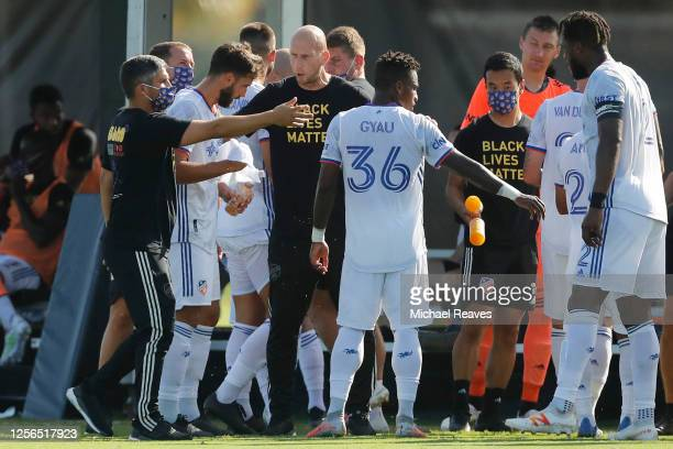 Head coach Jaap Stam of FC Cincinnati talks with Joseph-Claude Gyau during a Group E match against Atlanta United as part of the MLS Is Back...