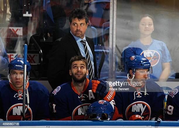 Head coach Jack Capuano handles the bench against the Pittsburgh Penguins at the Nassau Veterans Memorial Coliseum on November 22 2014 in Uniondale...