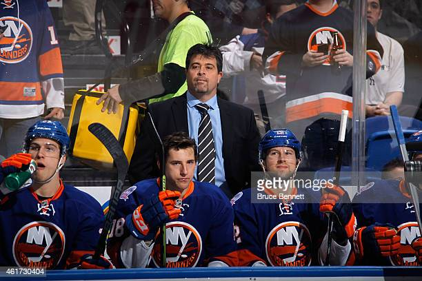 Head coach Jack Capuano of the New York Islanders handles the bench against the New York Islanders at the Nassau Veterans Memorial Coliseum on...