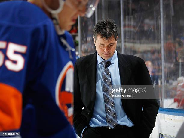Head coach Jack Capuano of the New York Islanders leaves the ice following a 50 defeat against the Detroit Red Wings at the Nassau Veterans Memorial...