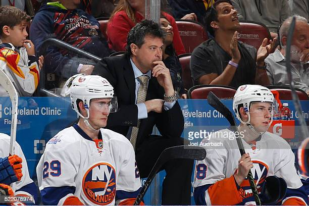 Head coach Jack Capuano of the New York Islanders looks on as the officials hand out penalties after a fight against the Florida Panthers in Game Two...