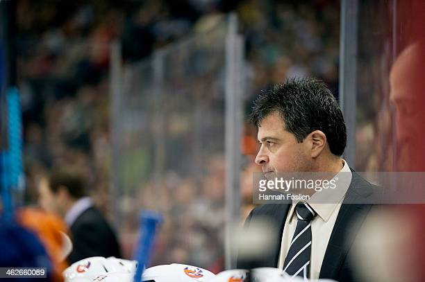 Head coach Jack Capuano of the New York Islanders looks on during the game against the Minnesota Wild on December 29 2013 at Xcel Energy Center in St...