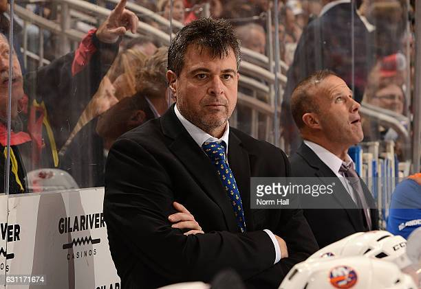 Head coach Jack Capuano of the New York Islanders looks on from the bench during the first period against the Arizona Coyotes at Gila River Arena on...
