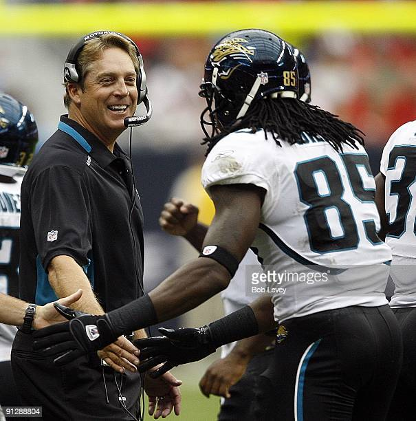 Head coach Jack Del Rio of the Jacksonville Jaguars celebrates with tightend Ernest Wilford after a first quarter score during the game against the...