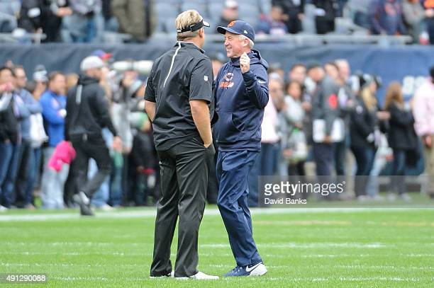 Head coach Jack Del Rio of the Oakland Raiders and head coach John Fox of the Chicago Bears talk prior to the game at Soldier Field on October 4 2015...