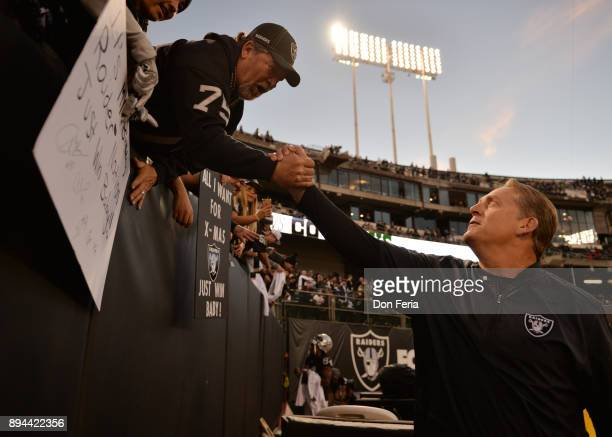 Head coach Jack Del Rio of the Oakland Raiders greets fans in the stands prior to their game against the Dallas Cowboys at OaklandAlameda County...
