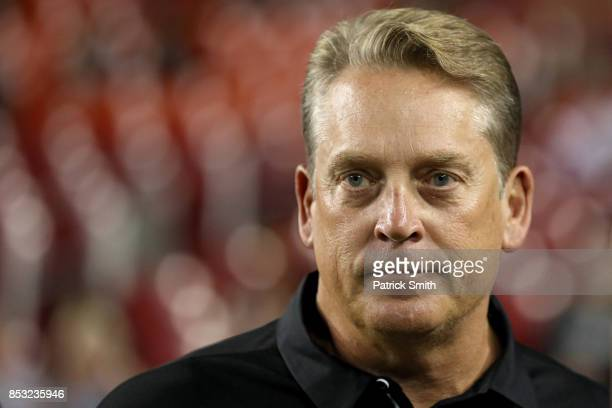 Head coach Jack Del Rio of the Oakland Raiders looks on before the Washington Redskins play the Oakland Raiders at FedExField on September 24 2017 in...