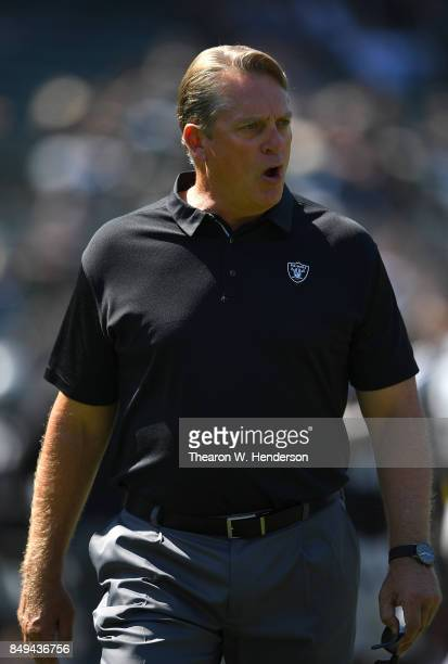 Head coach Jack Del Rio of the Oakland Raiders looks on while his team warms up during pregame warm ups prior to playing the New York Jets at...