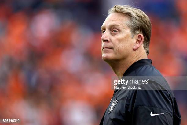 Head coach Jack Del Rio of the Oakland Raiders watches from the sidelines as his team plays the Denver Broncos at Sports Authority Field at Mile High...