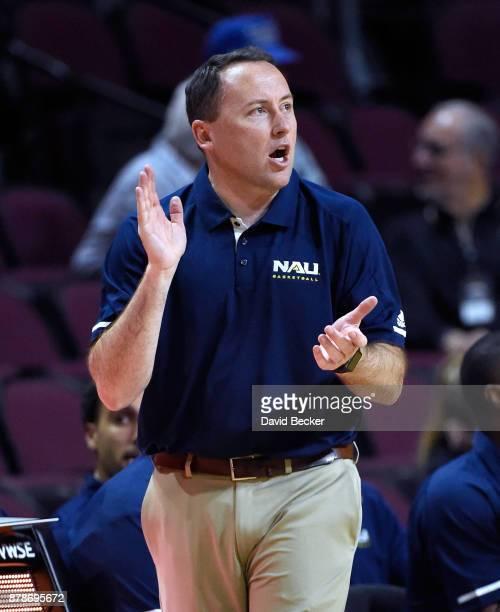 Head coach Jack Murphy of the Northern Arizona Lumberjacks applauds his team during the 2017 Continental Tire Las Vegas Invitational basketball...