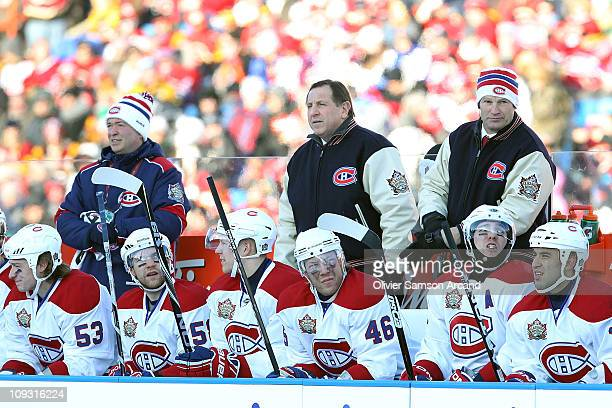 Head Coach Jacques Martin of the Montreal Canadiens and his coaching staff watch the game from the bench against the Calgary Flames for the 2011...