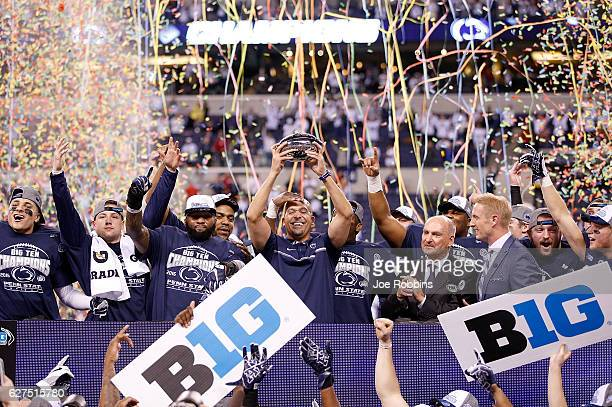 Head Coach James Franklin and the Penn State Nittany Lions celebrate after beating the Wisconsin Badgers 38-31 in the Big Ten Championship at Lucas...
