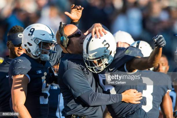 Head coach James Franklin of the Penn State Nittany Lions and Trace McSorley congratulate DaeSean Hamilton after a touchdown reception during the...