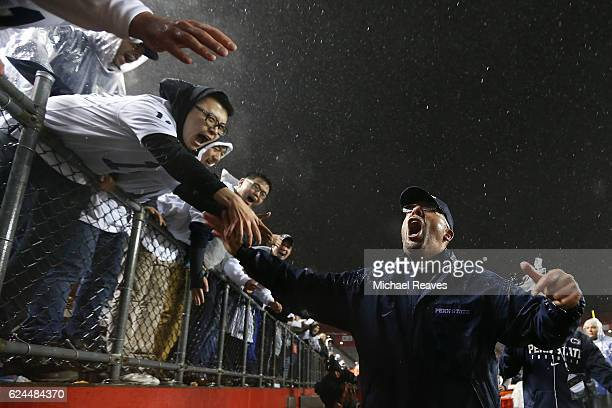 Head coach James Franklin of the Penn State Nittany Lions celebrates with fans agter they defeated the Rutgers Scarlet Knights 390 at High Point...