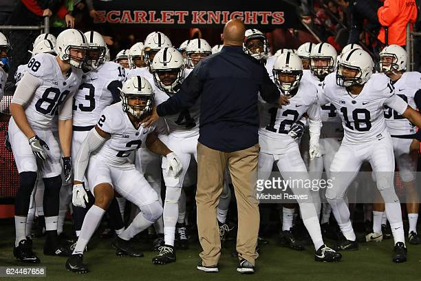 Head coach James Franklin of the Penn State Nittany Lions holds his team back as they prepare to take the field against the Rutgers Scarlet Knights...