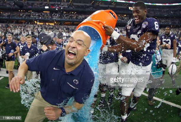 Head coach James Franklin of the Penn State Nittany Lions is soaked with the Gatorade cooler by Cam Brown of the Penn State Nittany Lions after the...
