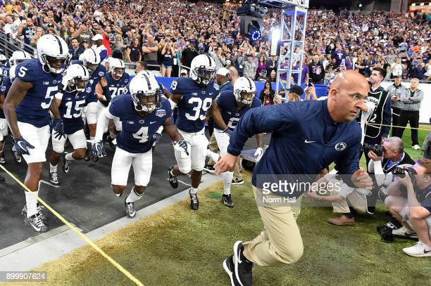 Head coach James Franklin of the Penn State Nittany Lions leads his team onto the field prior to the start of a game against the Washington Huskies...