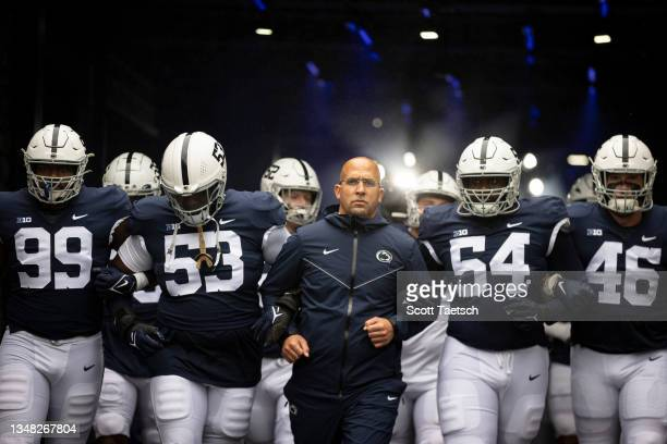 Head coach James Franklin of the Penn State Nittany Lions leads the team onto the field before the game against the Illinois Fighting Illini at...