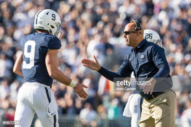 Head coach James Franklin of the Penn State Nittany Lions meets Trace McSorley with a high five on the sideline during the first half against the...