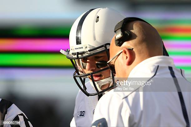 Head coach James Franklin of the Penn State Nittany Lions talks with Christian Hackenberg of the Penn State Nittany Lions on the sideline in the...