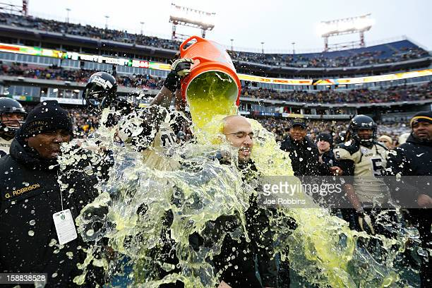 Head coach James Franklin of the Vanderbilt Commodores gets showered with Gatorade at the end of the game against the North Carolina State Wolfpack...