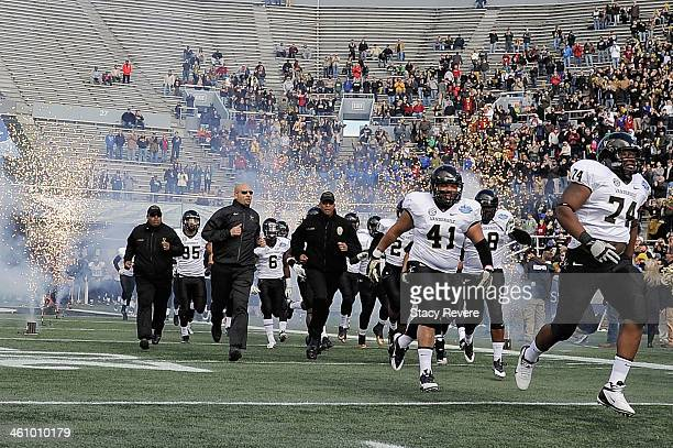 Head coach James Franklin of the Vanderbilt Commodores takes the field with his team prior to the BBVA Compass Bowl against the Houston Cougars at...