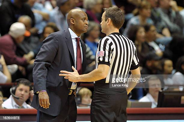 Head Coach James Johnson of the Virginia Tech Hokies talks to a referee during a game against the Duke Blue Devils at Cassell Coliseum on February 21...