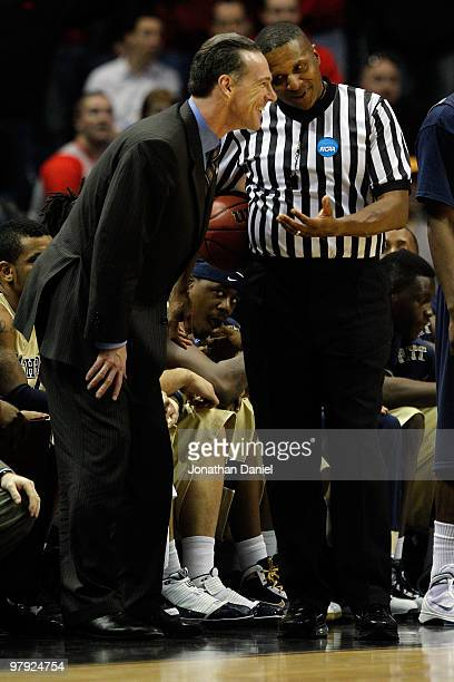 Head coach Jamie Dixon of the Pittsburgh Panthers talks with a referee about a call in the final minute against the Xavier Musketeers during the...