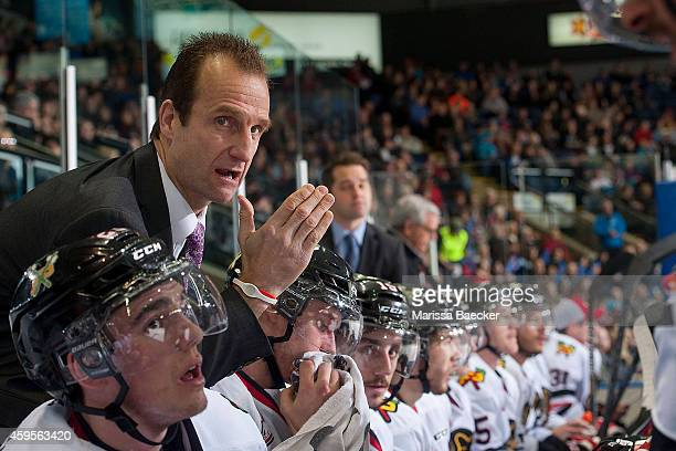 Head coach Jamie Kompon of Portland Winterhawks stands on the bench and speaks to players against the Kelowna Rocketson November 21 2014 at Prospera...